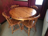 Solid pine exentendable dining table and four chairs.