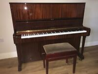 An upright piano in good condition. Recently tuned with 3 pedles.
