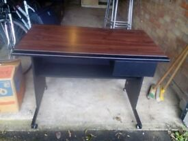 Black/brown wood/metal desk on casters with one drawer. FREE
