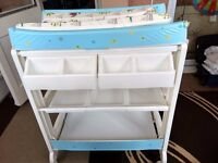Baby changing table with bath utility