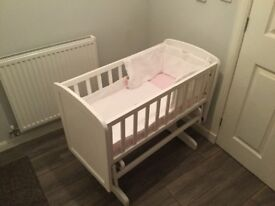 White swinging crib with swing lock + white bedding included never used