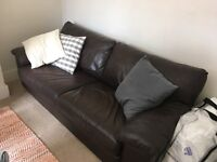 Large double sofa bed. Brown leather