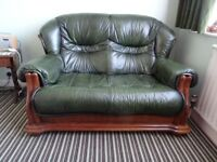TWO SEATER GREEN LEATHER SOFA / SETTEE