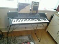 Yamaha psr 47 keyboard + stand + books + power supply