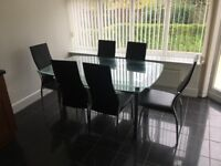 Glass dining table with 6 chairs in good condition