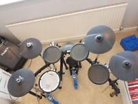 The Roland TD-4 V-Drums Portable Electronic Drum Kit