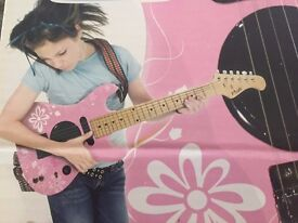 Girls Junior Pink Electric Guitar - Never opened - Brand New. Cost £55 - Sell £25.
