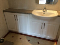 White vanitory unit with white basin , mirrored wall cabinet, white towel rail