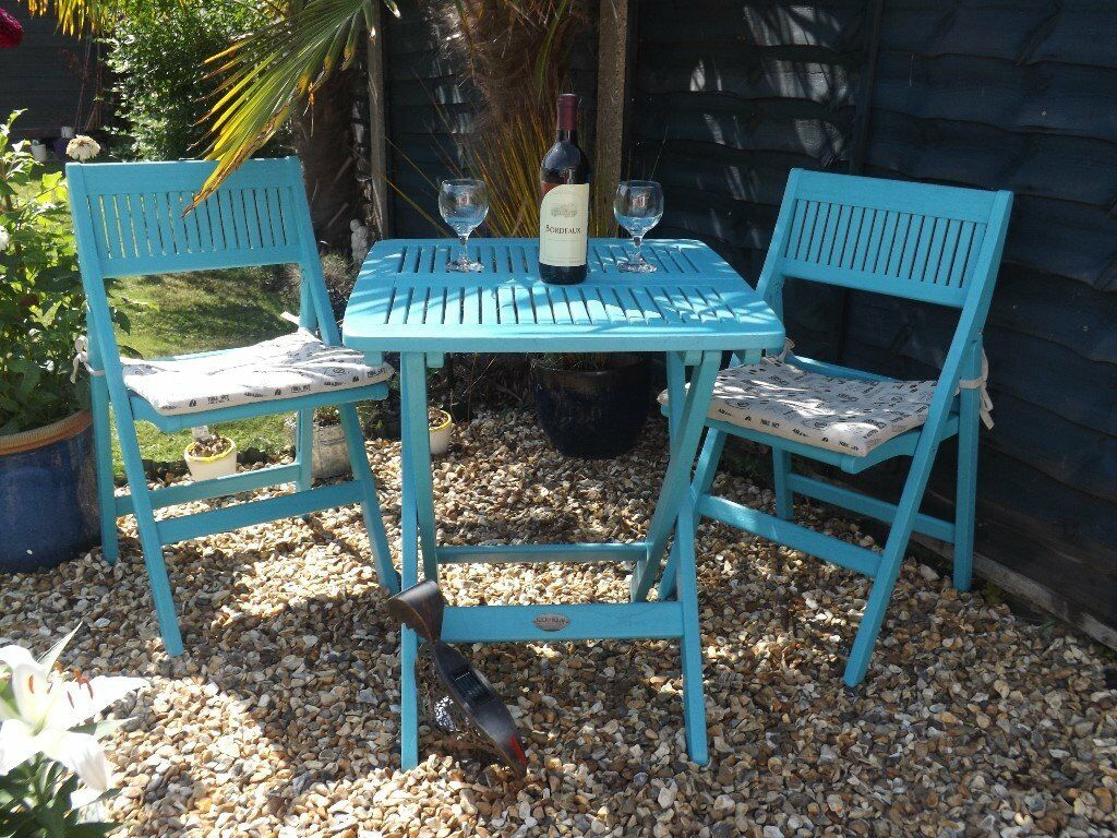 Folding garden furniture a teak painted bistro table and for Garden furniture table and chairs