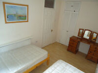 Share room is available now in clean flat, 5min walk to Barons Court Station ** no extra **