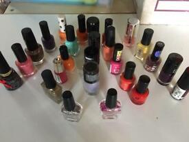 25 bottles of nail polish +2 bottles of gems