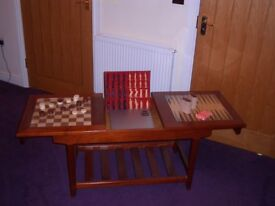 Wooden games table and a nice piece of furniture