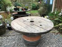Rustic upcycled beer barrel cable drum table
