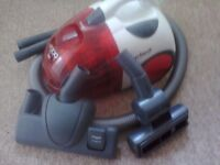 A Dirt Devil Vacuum cleaner with tools in good condition and working order.