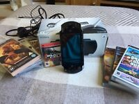 Sony PSP - PSP1003 with 9 Games, 1 Movie and Accessories