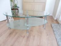 "very smart glass coffee table 39.5"" wide 16"" high 23.5""deep"