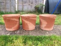 Set of swirly style terracotta garden plant pots