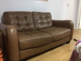 Two seater brown leather sofa DFS