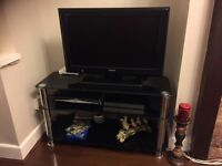 TV with Glass stand for sale