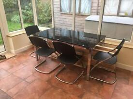 Black glass dining table with 4 leather chairs