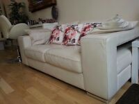 Lovely creme leather italian modern sofa. very good condition.