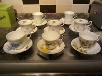 EIGHT BONE CHINA CUPS AND SAUCERS