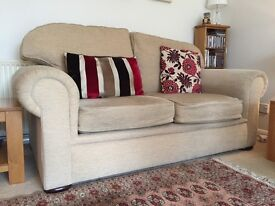Two cream sofas - one large and one medium