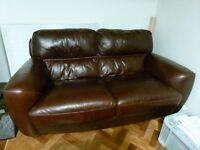 Leather settee - brown.