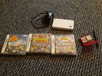 Nintendo DSI and charger and 7 games