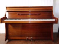 Rieslan mini upright piano, (7 octaves). Reconditioned and repolished and guaranteed 3 years