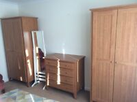 2 x pine effect wardrobes and matching chest of drawers