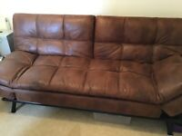 Sofa bed with faux leather look in brown