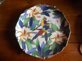 Chinese or Japanese style decorative plate with eye catching attractive flower and bird design