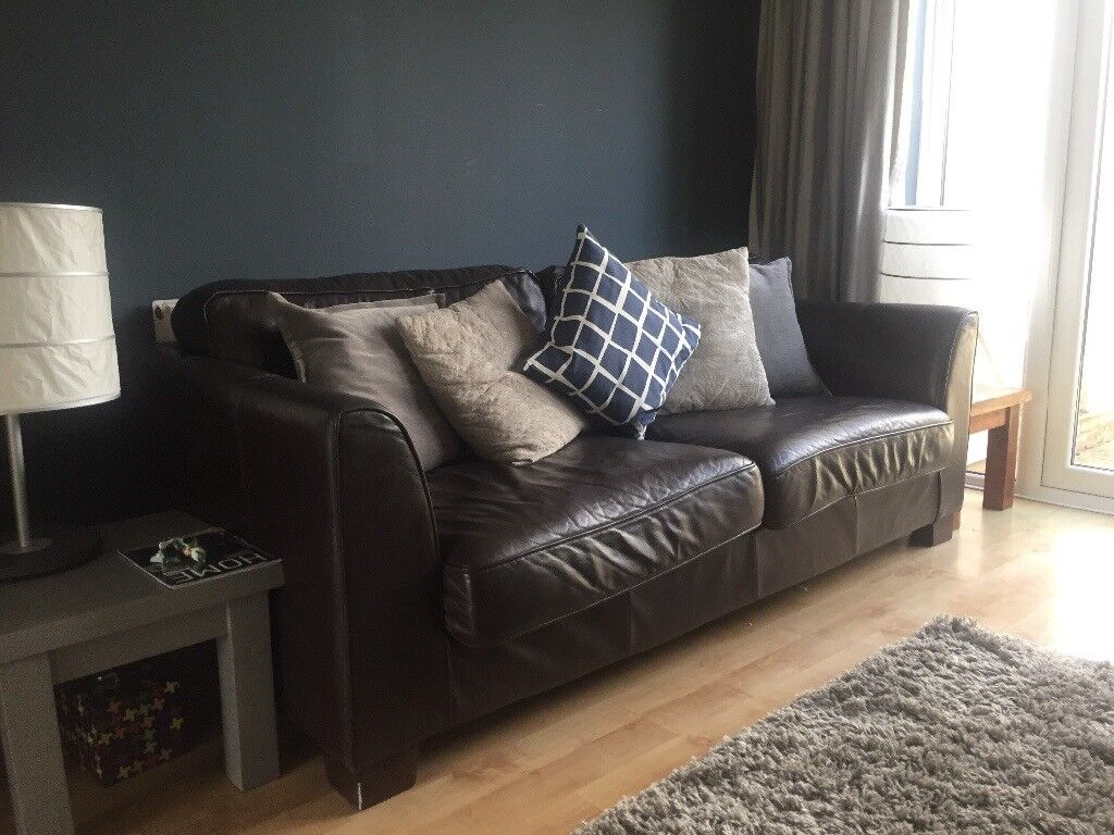 Beautiful brown real leather 4 seater chunky sofa. Few scratches but still got its lustre & chunky