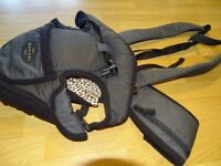 Tomy front baby carrier.
