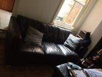 Brown faux leather three seater sofa