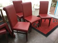 Red leather dining chairs 2 large and 6 normal size chairs and 1 footstool