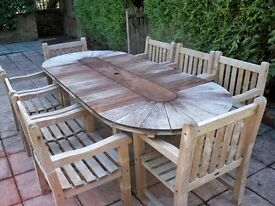 Large Hard Wood Oval Shaped Outside Dining Table & 8 Carver Chairs. Very Good Condition.