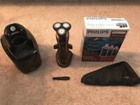 Phillips SensoTouch electric razor with electric cleaning machine.