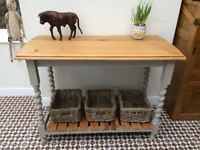 Solid oak console table with barley twist legs and lower shelf