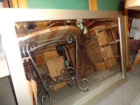 Mirror in metal look frame