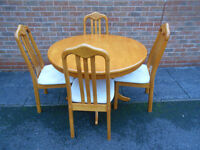 Round dining table with 4 chairs. Can deliver