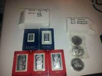 Silver coins and bars