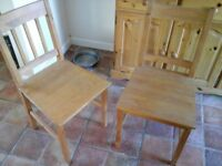 Pair of solid pine dining chairs.