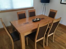 6/8 Seater extendable Oak dining table and 6 matching chairs. All in good condition.