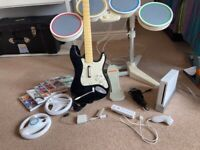 Nintendo Wii console & rock band set with accessories & games
