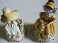 Two china musical box figurines. Female figures. period dress. Yellow/gold colourway.