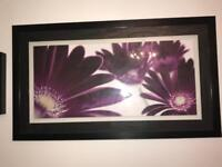 Black glass mirrored table and black frame flower picture