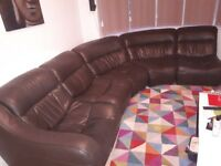 Large dark brown leather corner sofa with lounger