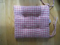 Four Red and Cream garden seat cushions for sale